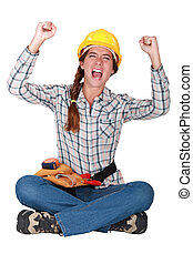 An ecstatic female construction worker.