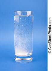 effervescent tablet - An effervescent tablet in the glass of...