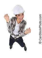 An elated tradeswoman