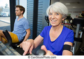 an elderly fit woman in the gym