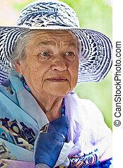 An elderly lady in a hat