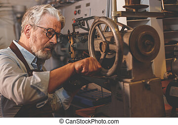 An elderly man at work