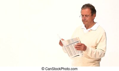 An elderly man reading newspaper with glasses isolated on a white background