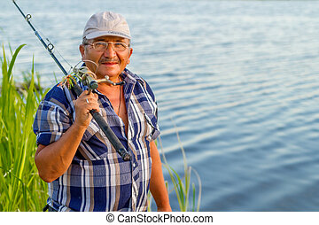 an elderly man with a fishing rod