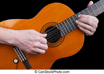 An elderly man with nervous hands plays a classic guitar retro music