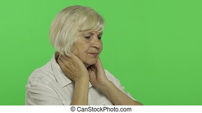 An elderly woman having pain in neck trouble. Old grandmother. Chroma key