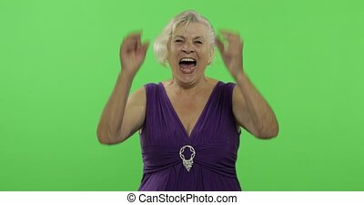 An elderly woman laughing. Old grandmother smiles. Chroma key