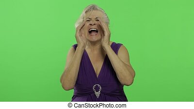 An elderly woman shout. Old grandmother smiles. Chroma key -...