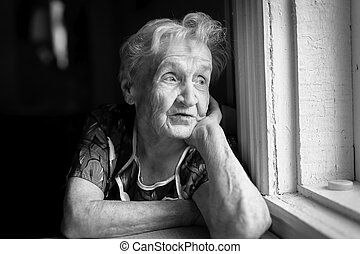 An elderly woman sitting