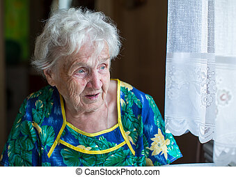 An elderly woman sitting