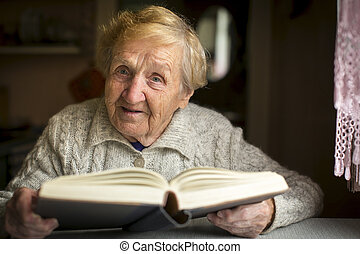 An elderly woman with a book
