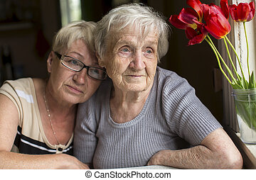 An elderly woman with her daughter