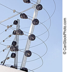 An Electric Fence Installaton Against Blue Sky - An electric...