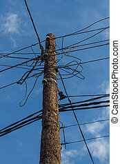 an electric pole with wires