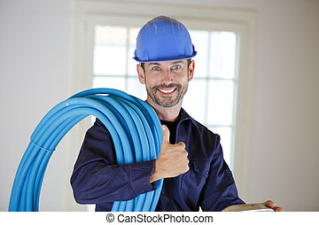 an electrician looking at camera