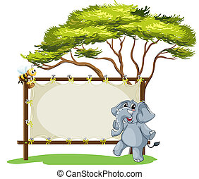 An elephant beside an empty framed signage