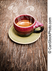 An elephant cup of espresso on wood