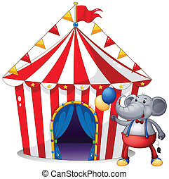 An elephant in front of the tent at the carnival -...