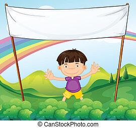 An empty banner above a little boy