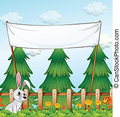 An empty banner near the fence with a rabbit