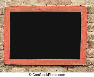 an empty blackboard hanged on brick wall