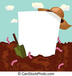 empty blank board with straw hat and garden trowel on ground with earthworms