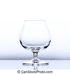 An empty cognac snifter in slightly blue light with a reflection