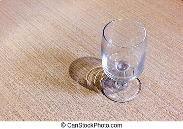 An empty glass goblet on the table
