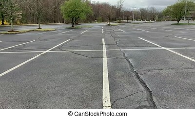 An parking lot of an office building with trees on the side of the street. Work From Home concept