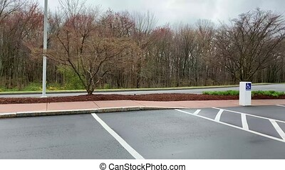 An empty parking lot showing handicap parking spaces on a bright spring day