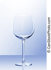 An empty red wine glass in slightly blue light
