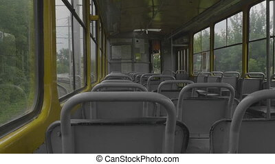 An empty tram rides around town, view from the cabin.