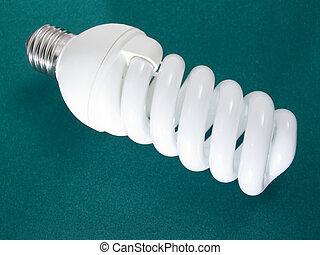 An energy efficient bulb on dark green background