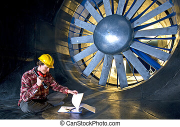 An engineer looking at his notes