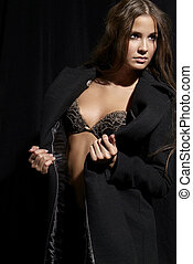 erotic woman - an erotic woman with bra and black overcoat