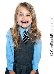 An excited school girl in uniform wearing braces - An active...