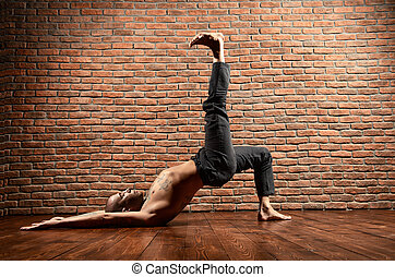 yoga poses - An experienced yoga instructor showing...