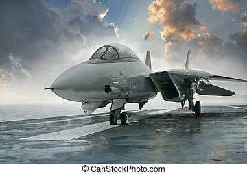An F-14 Tomcat jet fighter sits on the deck of an aircraft...