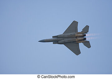 An F-15 strike eagle does a flyby with after-burners on