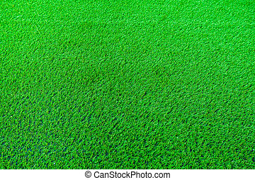 green artificial turf - An football field with green...