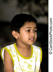 an handsome indian kid looking very thoughtful