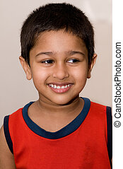 An handsome Indian kid smiling
