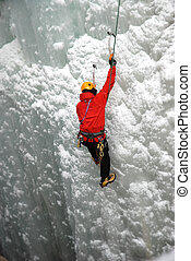 Ice Climber - An Ice Climber going up a frozen waterfall.