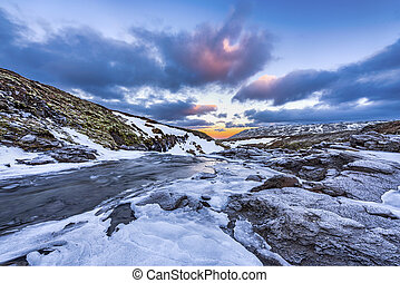 An icy river at sunrise in Iceland