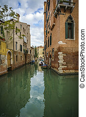 an idyllic view on a little canal in venice, italy