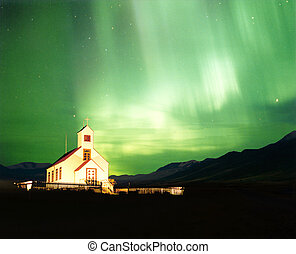 Aurora Borealis - An illuminated church with the magnificent...