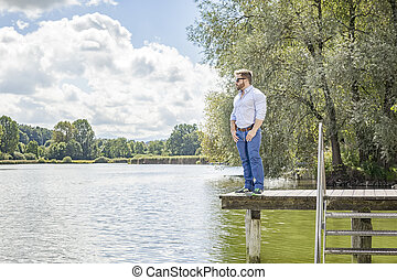 man at the lake