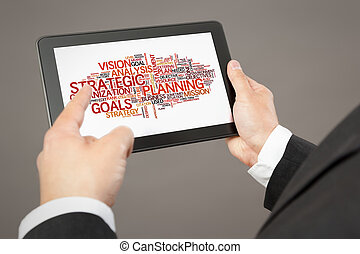 business man pointing to a tablet pc