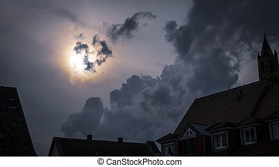 a dark scary full moon night sky