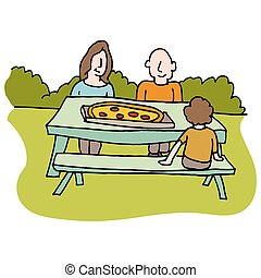 Family eating pizza at picnic table